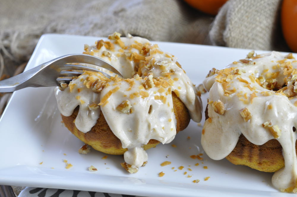 Pumpkin rum cakes with icing on serving dish.