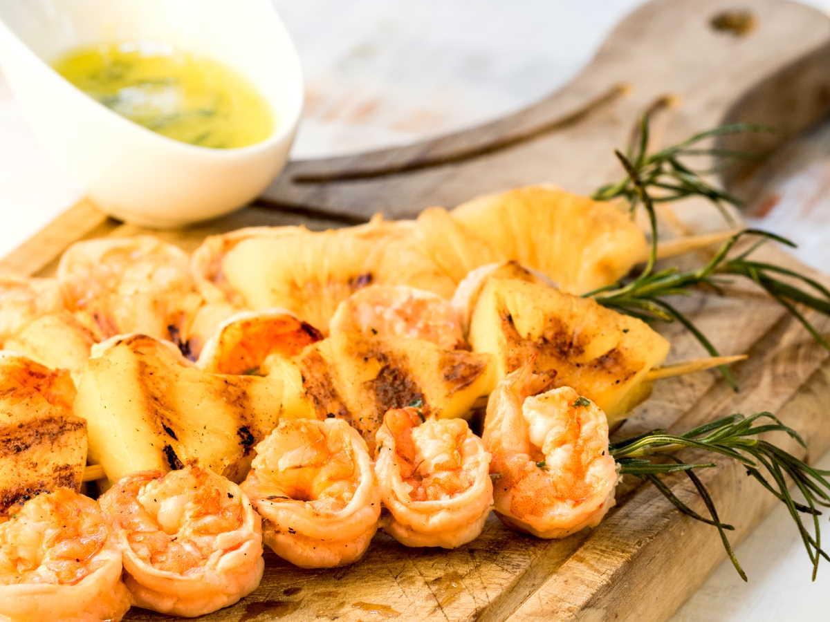 Shrimp on Rosemary Skewers with Rum-Soaked Pineapple wedges.