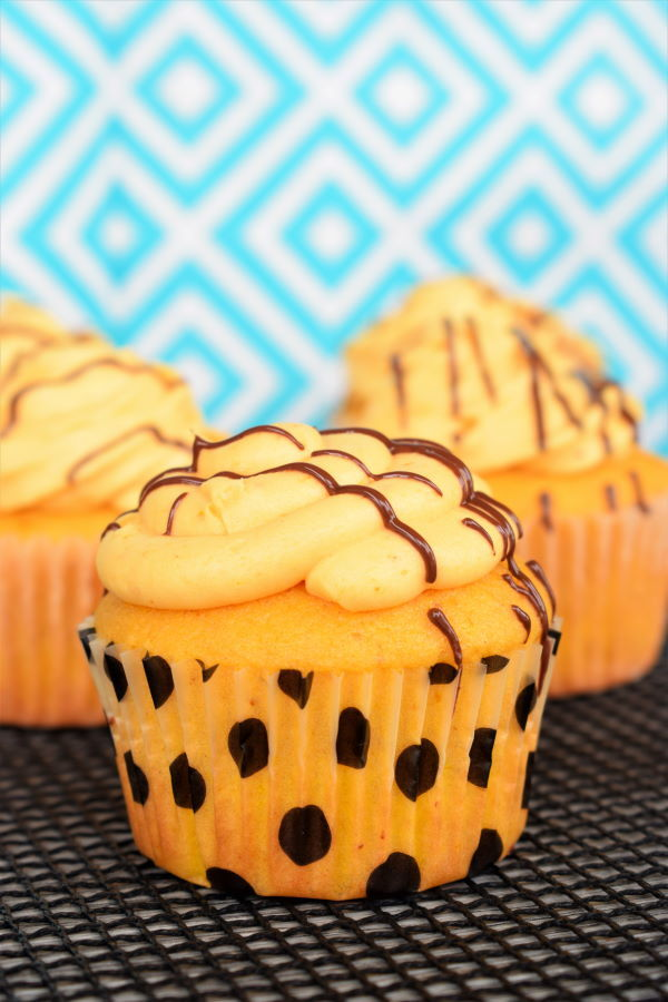 Pumpkin cupcakes with pumpkin buttercream and drizzled chocolate.
