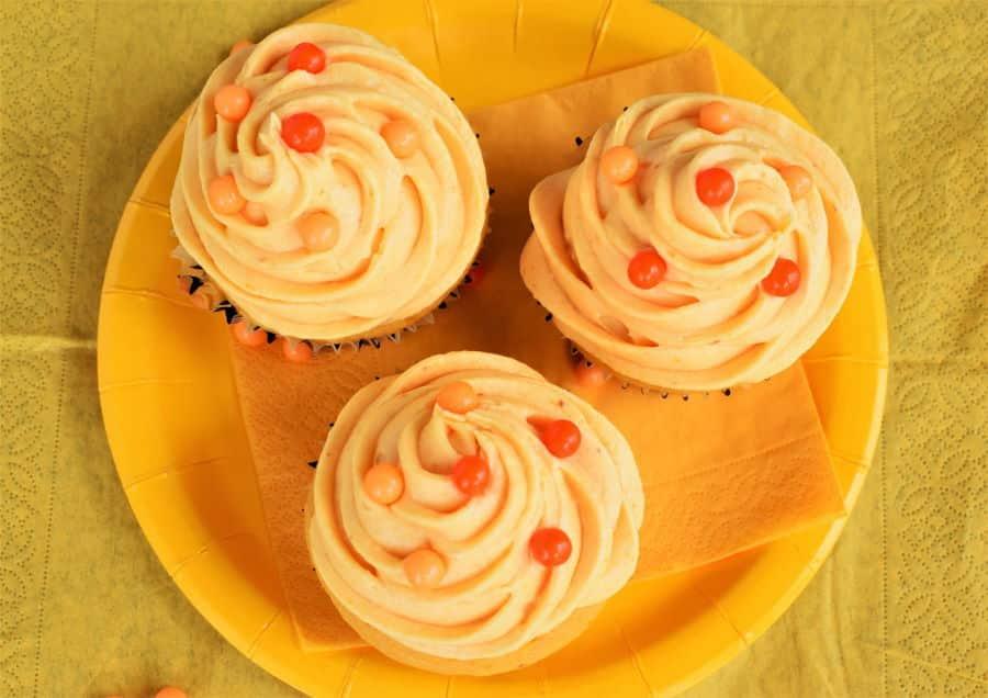 Pumpkin cupcakes with pumpkin buttercream and orange candy balls.