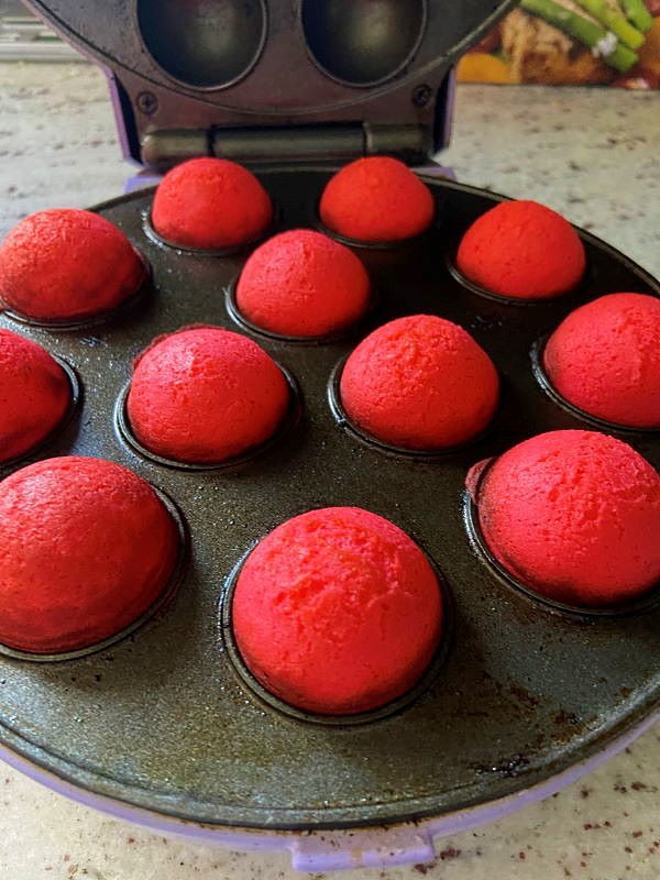 Valentines cake balls in a cake pop maker.