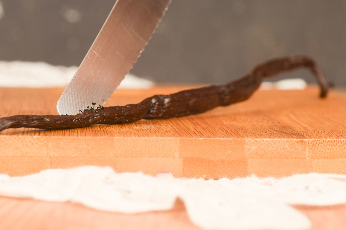 Slicing into a vanilla bean pod.