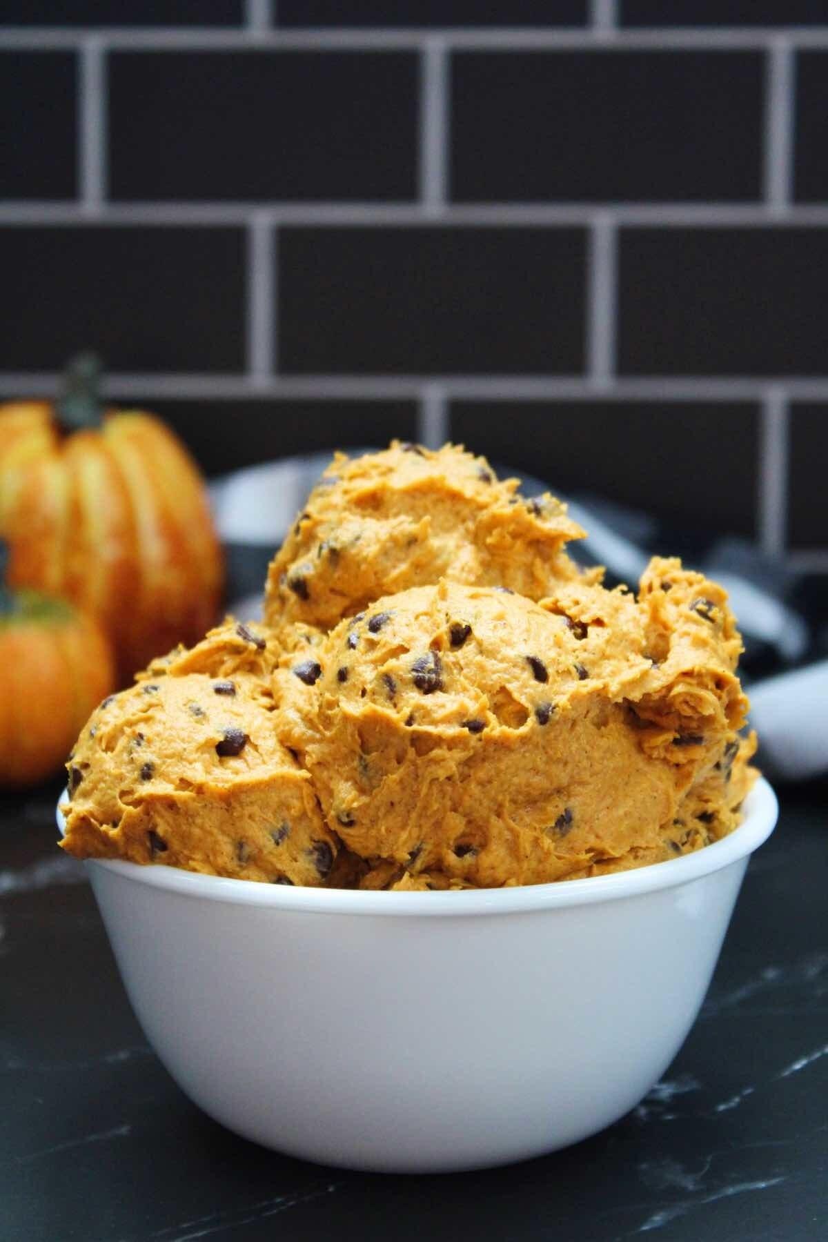 Edible pumpkin cookie dough in a white bowl.