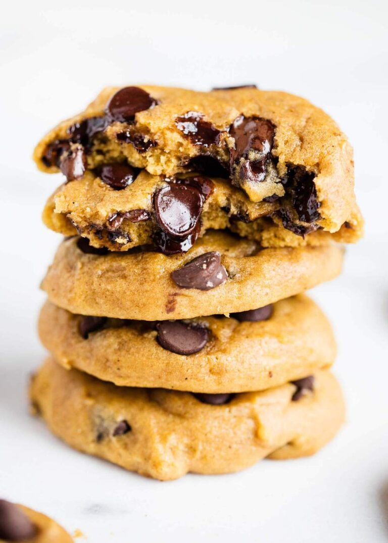 Stacked pumpkin chocolate chip cookies.